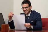 Young Businessman In Office Looking At Paper — Stock Photo