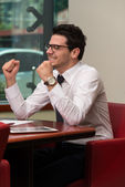 Successful Business Man With Arms Up At The Office — ストック写真