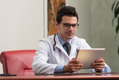 Young Doctor Working On Touchpad In Office — Stock Photo