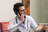 Young Doctor On The Phone — Stock Photo
