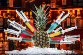 Colorful cocktails with pineapple in the syringe handle — Stok fotoğraf