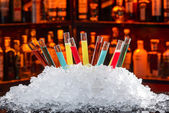 Colorful cocktails in a test tube — Stock Photo