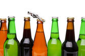 Different bottlenecks with a bottle opener — Stock Photo
