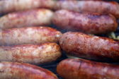 Bratwurst sausages on grill close-up — Stock Photo