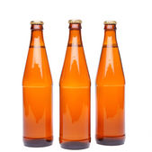 Three brown beer bottle — Stock Photo