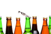 Top bottles of beer and a opener — Stock Photo