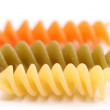 Close-up pasta eliche tricolori are located — Stock Photo #27115931