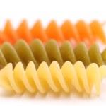 Close-up pasta eliche tricolori are located — Stock Photo
