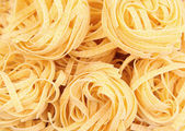 Pasta fettuccine background — Stock Photo