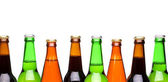 Row from beer bottles. — Stock Photo