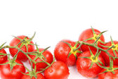 Two clusters of small red tomatoes — Stock Photo