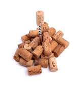 Corkscrew and wine corks close-up — Stock Photo