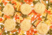 Different pasta in three colors close-up. — Stock Photo