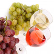Glasses of wine and ripe grapes isolated on white — Stock Photo