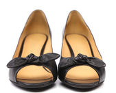 Black female shoes with a bow. — Stock Photo