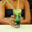 Green alcoholic cocktail in a tall glass — Stock Photo