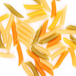 Penne colored pasta isolated on white background — Stock Photo