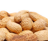Some peanuts are located to the left. — Stock Photo