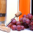 Corkscrew, cork, grape. Barrel and bottles. — Stock Photo