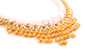 Necklace of gold pearls on a white bacground — Stock Photo