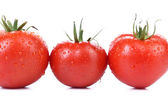 Three red ripe tomatoes isolated — Stock Photo