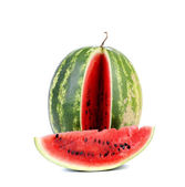 Big ripe watermelon and slice — Stock Photo