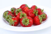 Fresh red ripe strawberries on plate. — Stock Photo