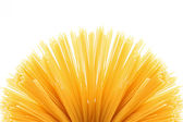 Fan of raw pasta spaghetti macaroni — Stock Photo