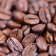 Roasted coffee beans, can be used as a background. — Stock Photo #28679267