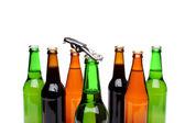 Opener. Bottlenecks. Bottles of beer. Close up. — Stock Photo