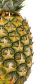 Pineapple is located half of a white background — Stock Photo