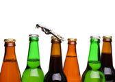 Top bottles of beer and a opener. — Stock Photo