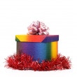 Colourful present box and pink bow. — Stock Photo