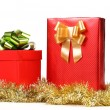 Two red boxes with bows and tinsel. — Stock Photo