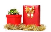 Dvě červené boxy s luky a kejklířů. — Stock fotografie