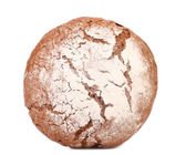Brown bread dusted the flour. — Stock Photo
