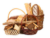 Fresh bread in baskets isolated on white — Stock Photo