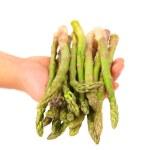 Fresh green asparagus on hand. — Stock Photo #30295837