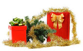 Gift boxes with Christmas tree and tinsel. — Stock Photo