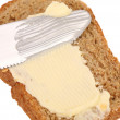 Smear butter on bread the knife. — Stock Photo