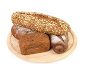 Shot of assorted bread in a wooden tray — Stock Photo