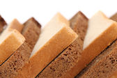 Slices of brown and white bread. — Stock Photo