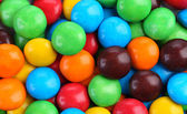 Chocolate drops with bright color candy coating. — Stock Photo
