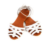 Pair of white leather female sandals — Stock Photo