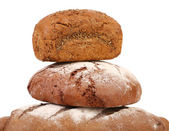 Pyramid of brown breads. — Stock Photo