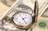 Vintage watch and dollars — Stock Photo