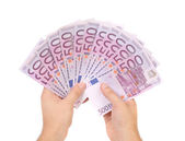 Hands holding 500 euros banknotes — Stock Photo