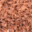 Grated chocolate. Macro. — Stock Photo