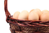 Close up of eggs into basket. Space for text. — Stock Photo