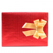 Red present box with asterisks and golden bow. — Stock Photo